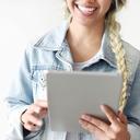 image of a girl looking at an ipad